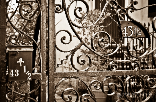 Wrought Iron gate with a half address