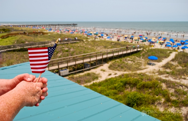 A customer holds an American flag at Coconut Joe's Beach Grill & Bar on Isle of Palms, SC.
