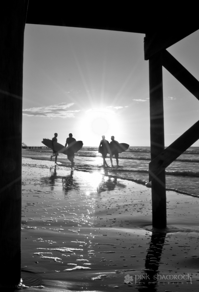 """Sol Surfers"" - Surfers silhouetted by the sunrise on Folly Beach, SC."
